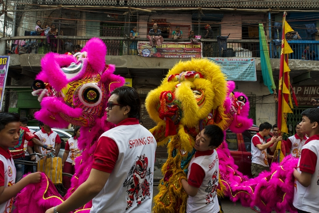 Young Chinese-Indian boys and girls make merry on the streets of old China Town in Kolkata on the day of Chinese New Year. They take out colourful processions characterised by traditional dragon dance and drums.