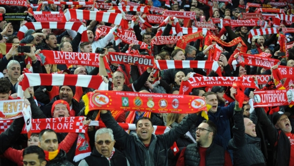 "Liverpool fans sing ""You'll Never Walk Alone"" as they hold up scarves prior to the Champions League semifinal, first leg."