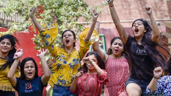 Students celebrate after the results are declared.