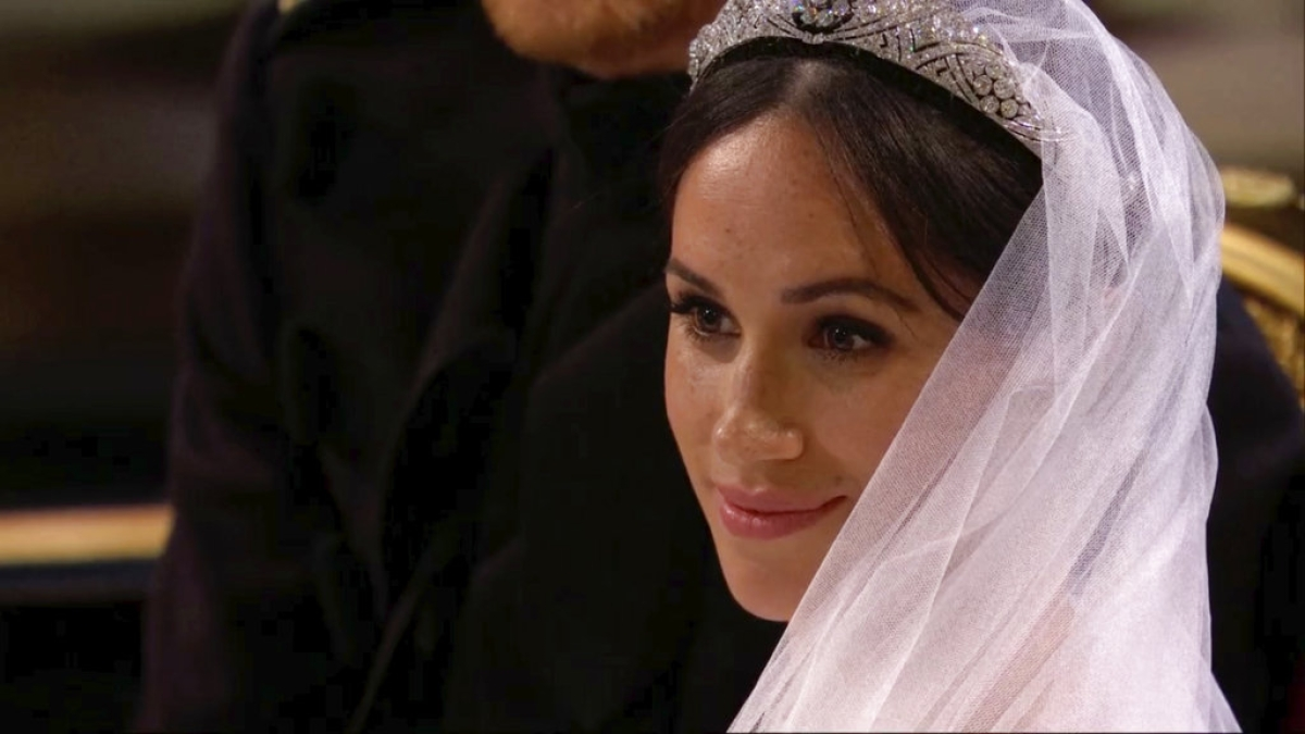 Meghan Markle listens during her wedding ceremony with Britain's Prince Harry at St. George's Chapel in Windsor Castle in Windsor, near London, England, Saturday, 19 May, 2018.
