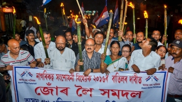 Activists of Asom Gana Parishad (AGP) led by former Assam chief minister Prafulla Kumar Mahanta take out a torch light rally objecting to Citizenship (Amendment) Bill, 2016 in Guwahati.