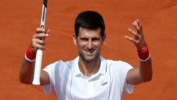 Serbia's Novak Djokovic celebrates winning his second round match of the French Open.