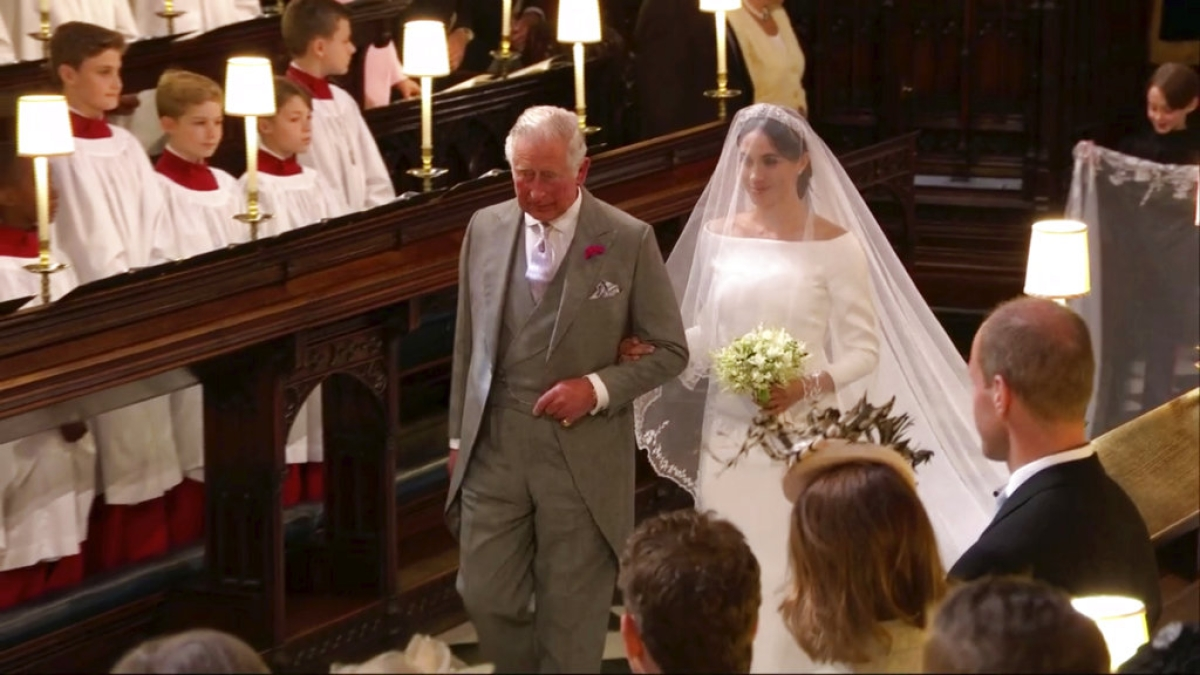 Meghan Markle walks down the aisle with Prince Charles for her wedding ceremony at St George's Chapel in Windsor Castle in Windsor, near London, England, Saturday, 19 May, 2018.