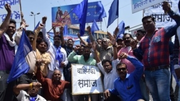 Bhopal: People stage a demonstration during a nation wide strike called to protest against the dilution of the SC/ST Prevention of Atrocities Act in Bhopal, on April 2, 2018.