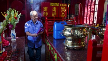 An elderly Chinese-Indian man offers prayer at a Chinese temple of Guan Yu, the traditional god of war, in Kolkata. The Chinese-Indians – Buddhists and Christians – regularly visit temples of Chinese gods and goddesses.