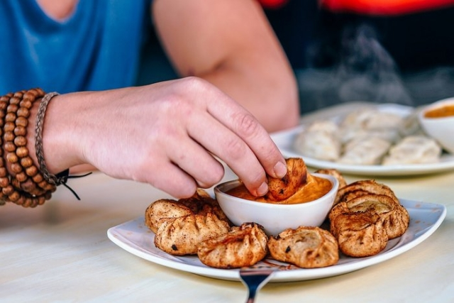 "Yes, there is a picture of dumplings here – or momos as we call them – because that was my favourite street food while I was living in <a href=""https://drifterplanet.com/places-to-visit-in-delhi/"">Delhi</a>."