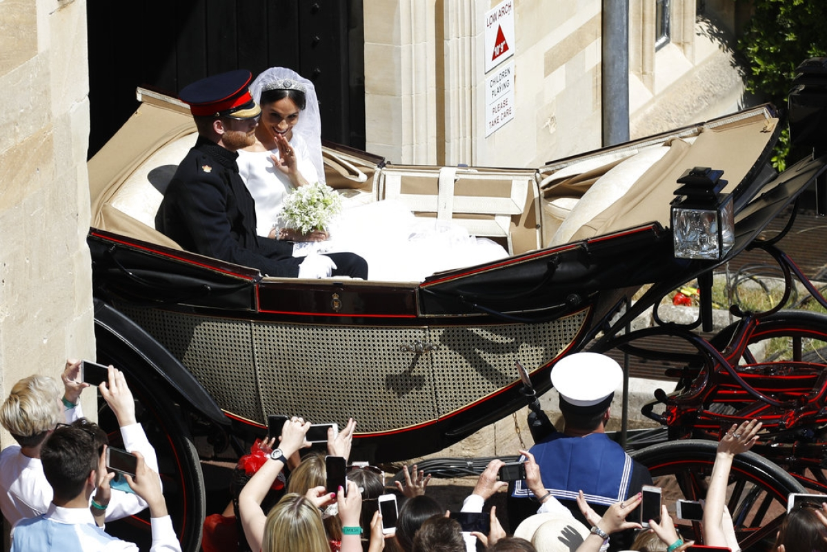 Britain's Prince Harry and Meghan Markle leave in a carriage after their wedding ceremony at St George's Chapel in Windsor Castle in Windsor, near London, England, Saturday, 19 May, 2018.
