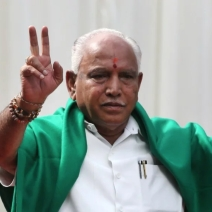 BJP's BS Yeddyurappa flashes victory sign after he was sworn in as chief minister of Karnataka in Bangalore.