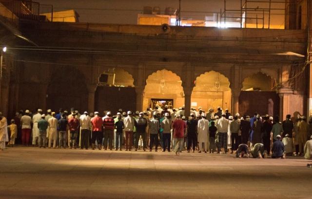 Devotees offering the morning prayer or <i>'fajr namaaz'.</i>