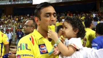 Ziva and dad MS Dhoni share a celebratory drink after CSK lifted the IPL 2018 trophy.