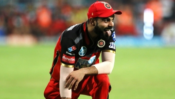 Royal Challengers Bangalore kept their play-off hopes alive by beating Sunrisers Hyderabad by 14 runs on Thursday.