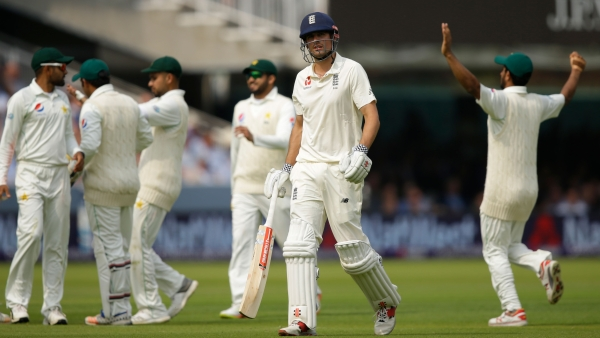 England's Alastair Cook walks from the pitch after being bowled out by Pakistan's Mohammad Amir during the first day of play of the first Test cricket match between England and Pakistan.