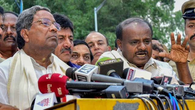 Karnataka Congress leader Siddaramaiah (left) with Chief Minister HD Kumaraswamy.