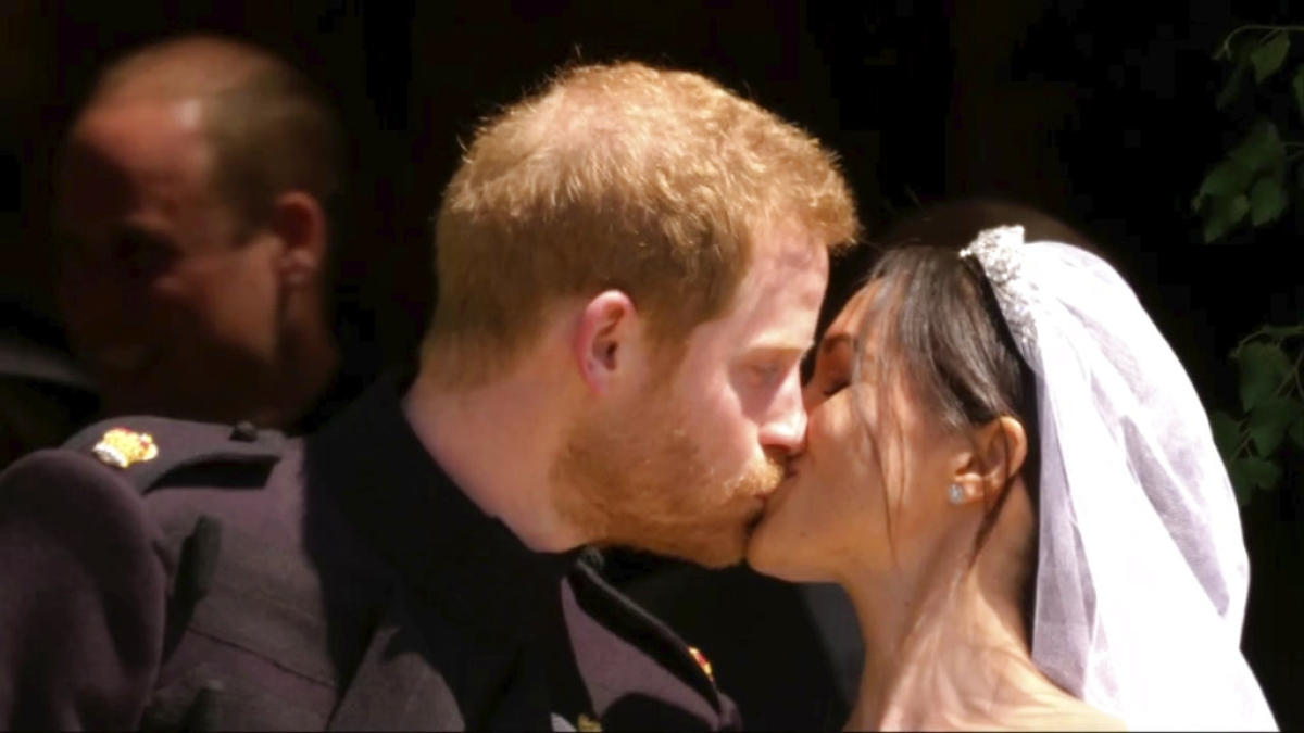 Britain's Prince Harry and Meghan Markle kiss after their wedding ceremony at St George's Chapel in Windsor Castle in Windsor, near London, England, Saturday, 19 May, 2018.