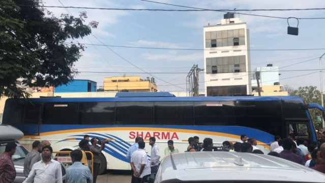 A bus arrives at the Congress' Bengaluru headquarters to take the MLAs to a resort