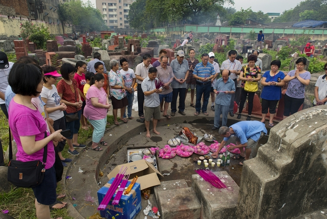 The Chinese-Indian community observes the Hungry Ghost Festival twice a year to pay respect and 'feed' the departed souls at a cemetery in Kolkata. According to the Chinese belief, restless ghosts roam the earth during this time of the year and must be pacified with food and drinks.