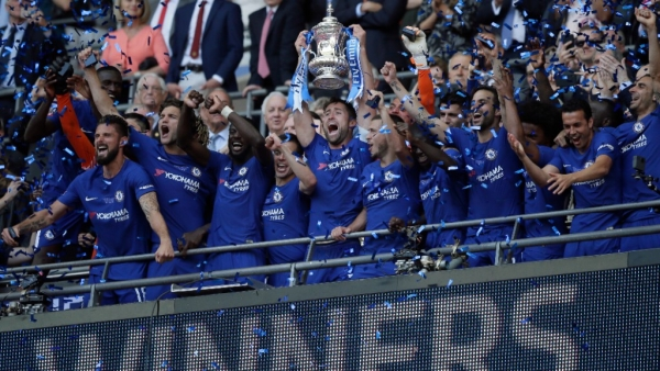 Chelsea captain Gary Cahill lifts the trophy after winning the English FA Cup final against Manchester United at Wembley stadium in London on Saturday.