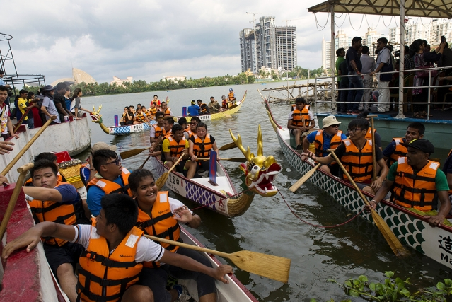 Young Chinese-Indians and their local friends during the annual Dragon Boat Race. These boats have been brought from China.