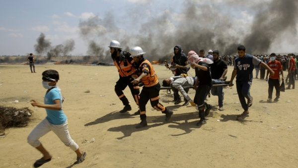 Palestinian medics and protesters evacuate a wounded youth during a protest at the Gaza Strip's border with Israel. Image used for representational purpose.