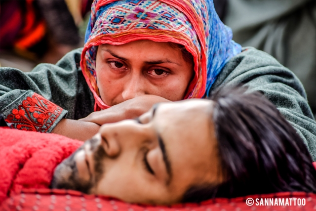 Sharjeel Ahmad Sheikh, a 30-year-old driver, was going to get married in a few days but lost his life in an encounter in Kulgam district. His fiance looks at his corpse as she mourns in death.
