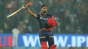 Rishabh Pant celebrates after scoring a century.