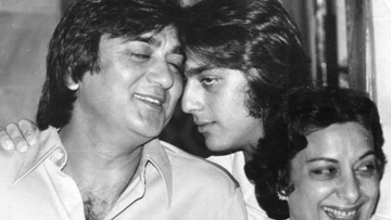 Sunil Dutt shares a moment with son Sanjay, with Nargis for company.