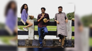 Mithila Palkar, Dulquer Salmaan, and Irrfan Khan in a still from <i>Karwaan</i>.