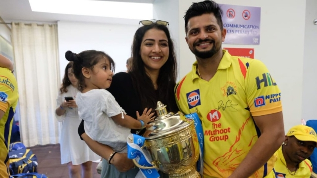 DJ Bravo photo-bombs the Raina's perfect family moment.