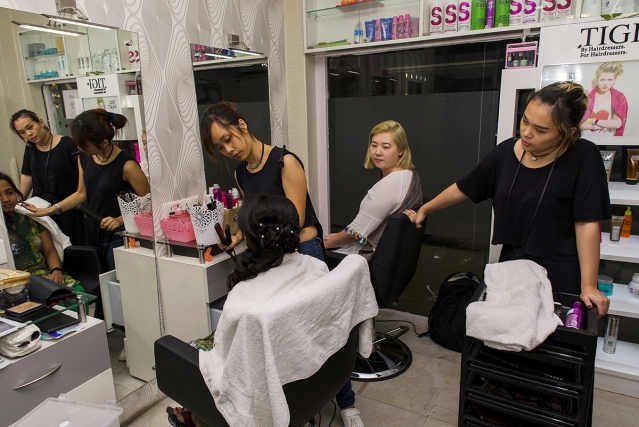 Amy Stacy, a hair dresser, and Sne Aribam, a makeup artist, engaged in work at a beauty salon in Kolkata.