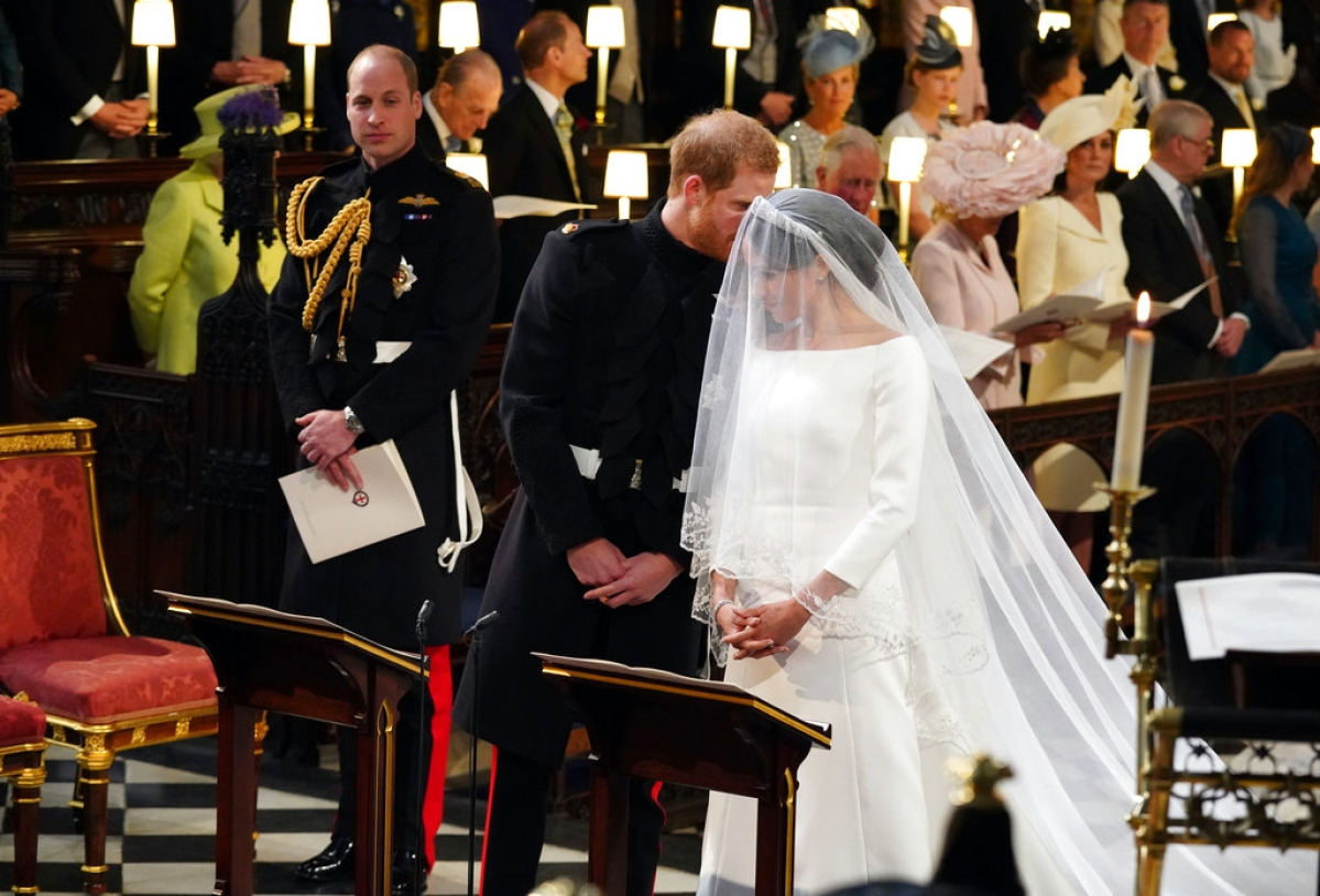 Britain's Prince Harry speaks to his bride, Meghan Markle, during their wedding ceremony at St George's Chapel in Windsor Castle in Windsor, near London, England, Saturday, 19 May, 2018.