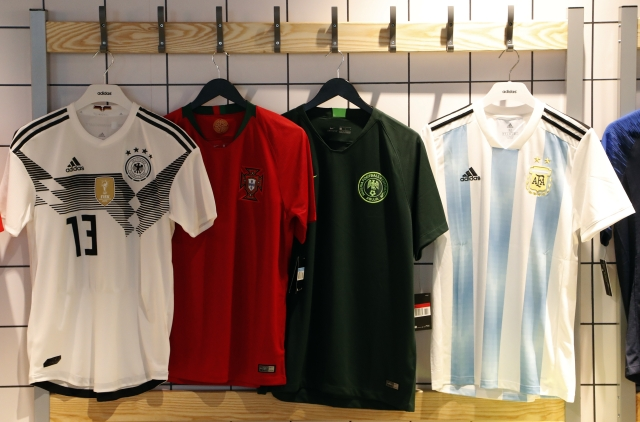 National soccer team jerseys of Germany, from left, Portugal, Nigeria (away) and Argentina are on display at a shop in London.