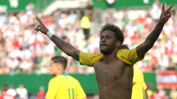 Brazil's Neymar celebrates after scoring his side's second goal during a friendly soccer match between Austria and Brazil.