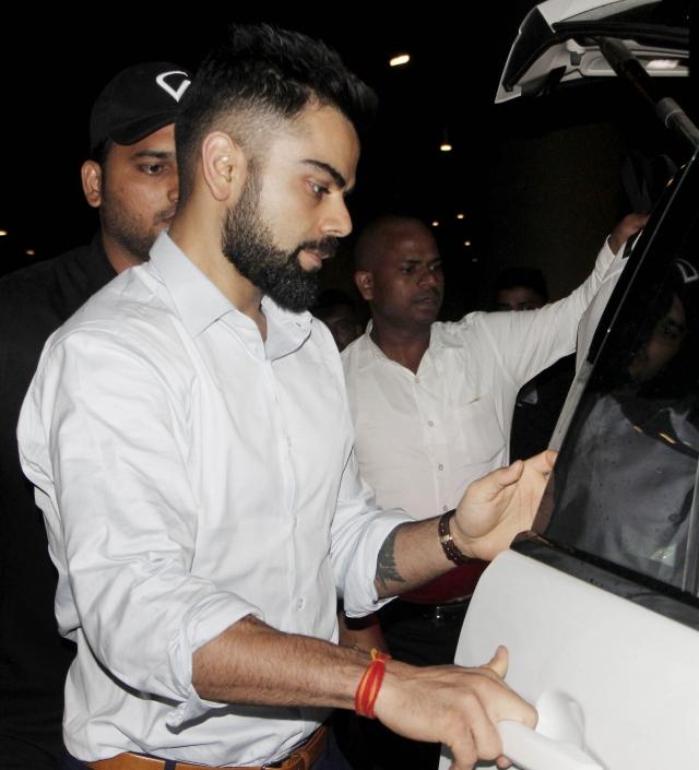 Virat Kohli looking sharp as ever at the airport.