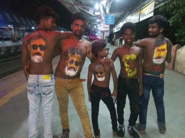 Rajinikanth fans gear up at midnight at Mumbai's Wadala Station.
