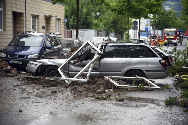 A car is destroyed after an explosion of a house in Wuppertal, Germany, 24 June, 2018.