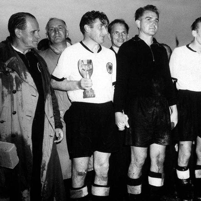 """West Germany captain Fritz Walter with the Jules Rimet trophy after the """"Miracle of Bern"""" in 1954."""