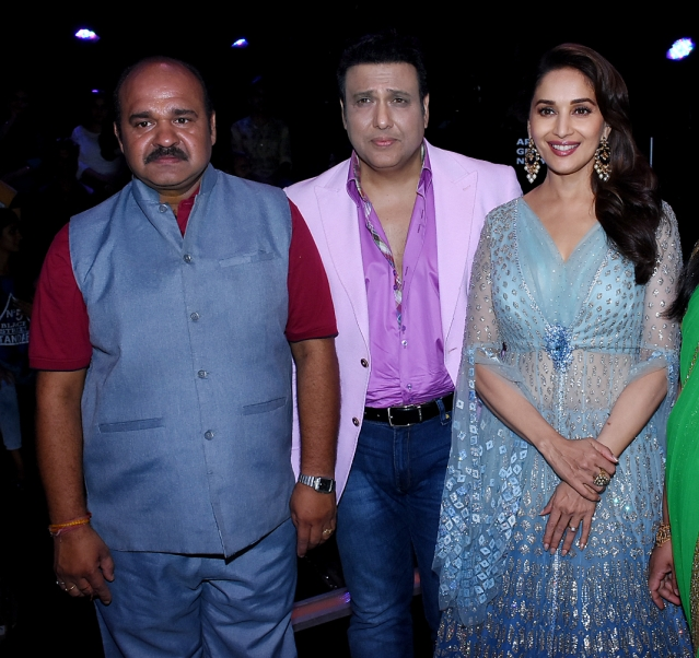 Sanjeev Shrivastava poses with Govinda and Madhuri Dixit.