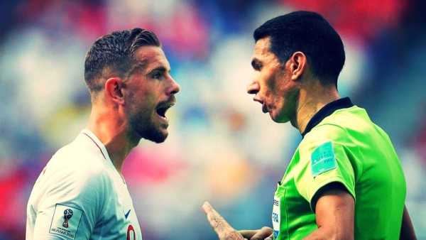 Referee Ghead Grisha from Egypt admonishes England's Jordan Henderson during a group match at the FIFA World Cup.