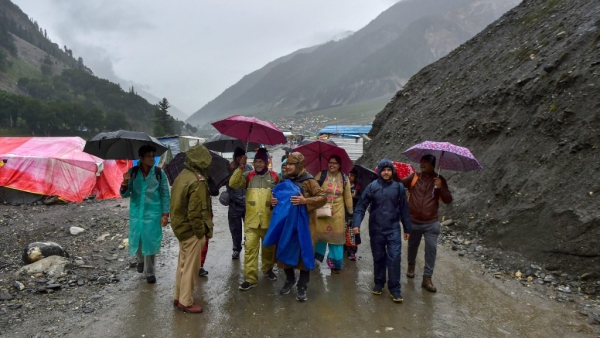 First batch of Amarnath pilgrims arrive at the base camp at Baltal, in Ganderbal district of central Kashmir on Thursday, 28 June.