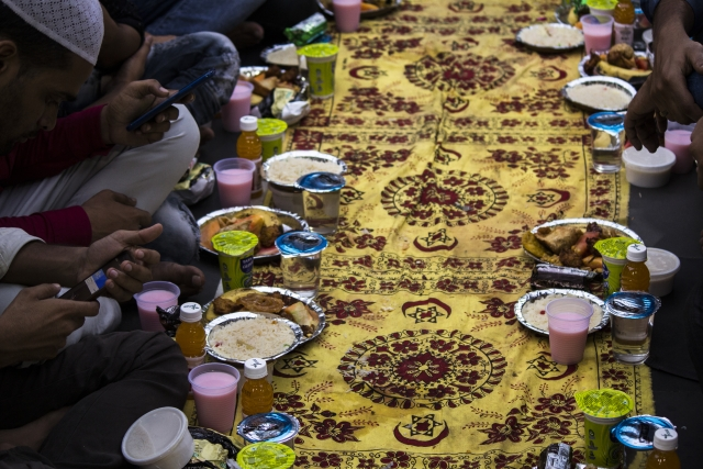 Dastarkhwan (mats) are spread and people dine together.