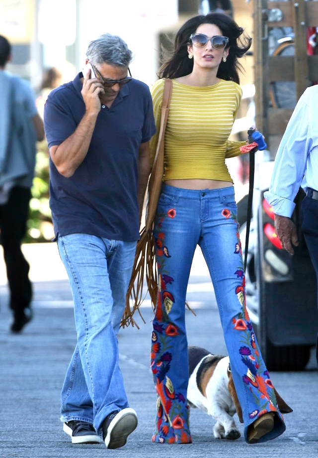 Amal Clooney visited George Clooney on a film set in embroidered wide-legged denims and she totally rocked the look!