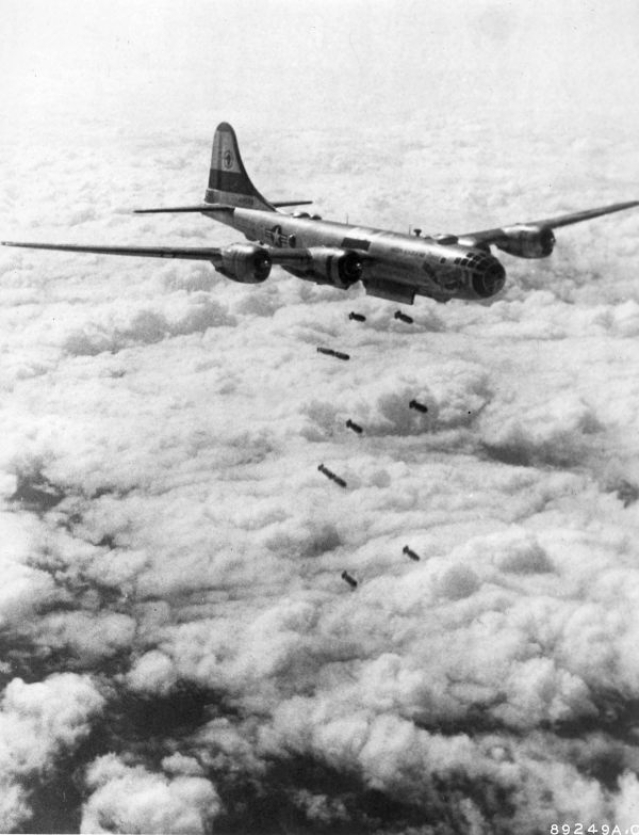 "Husky 1,000-pound demolition bombs hurtle from this US Far East Air Forces B-29 ""Superfort"" of the 19th Bomb Group toward a Red target somewhere beneath the cloud layers in Korea, August 1951."