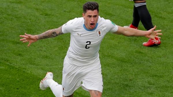 Uruguay's Jose Gimenez scores the opening goal against Egypt at the Yekaterinburg Arena on Friday.