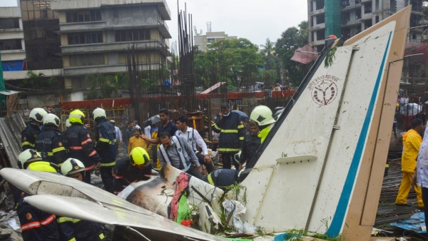 The plane hit an open area at a construction site for a multi-story building in a crowded area with many residential apartments.