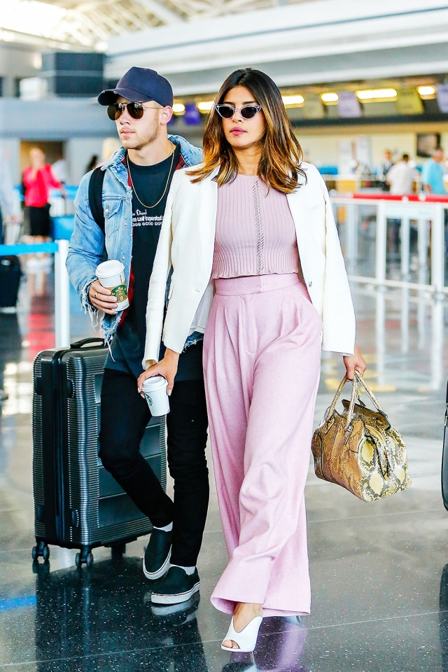 Priyanka Chopra looks chic in powder pink wide-legged trousers while on a coffee date with Nick Jonas.