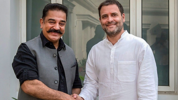 Congress President Rahul Gandhi and actor-turned politician Kamal Haasan shake hands during a meeting in New Delhi on Wednesday, 20 June 2018.