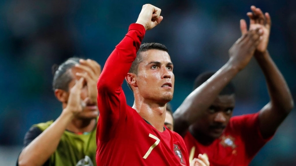 Portugal's Cristiano Ronaldo gestures to the fans at the end of the group B match against Spain.
