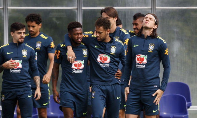 Brazil's Neymar puts his arm around Fred during the training session at Enfield Training Ground, London, Britain on 5 June 2018.