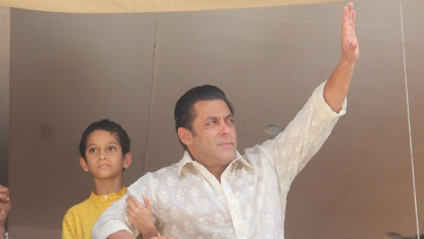 Salman Khan waves to his fans waiting outside his apartment.