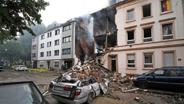 The detonation was so severe it destroyed the building's attic and the top three floors, a German news agency reported.